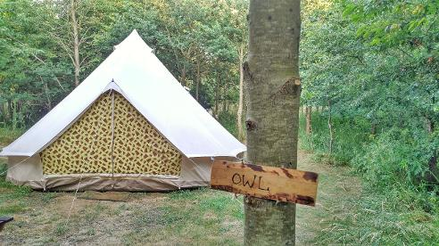 Owl-themed glamping Bell tent at Woodland Escape in Somerset