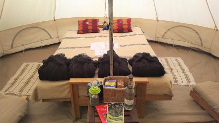Interior of the Squirrel Bell tent at Woodland Escape glamping in Somerset