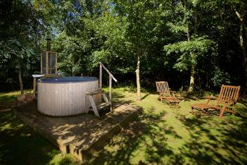 Hot tub glamping in Somerset at Woodland Escape