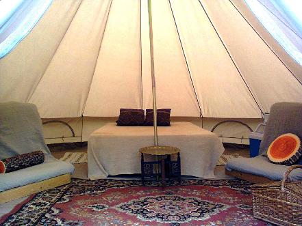 Interior of a glamping Bell tent at Woodland Escape in Somerset